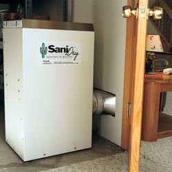 A basement dehumidifier with an ENERGY STAR® rating ducting dry air into a finished area of the basement  in Champlin