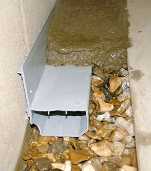 A basement drain system installed in a Coon Rapids home