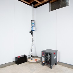 Sump pump system, dehumidifier, and basement wall panels installed during a sump pump installation in Stillwater
