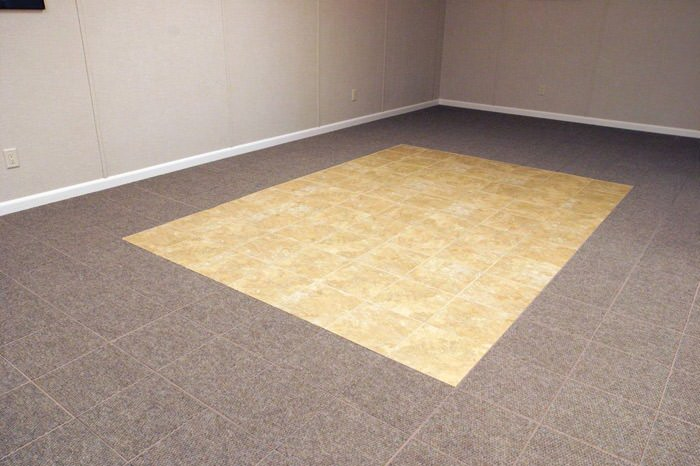 tiled and carpeted basement flooring installed in a Saint Cloud home